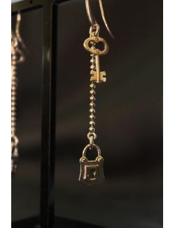 Coppia di orecchini in argento con lucchetto e chiavi